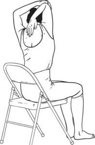 picture of a lady seated performing a triceps stretch for the back of the arm