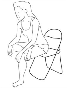 Picture of a lady performing a seated gluteal stretch