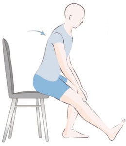 picture of a man seated performing a hamstring stretch